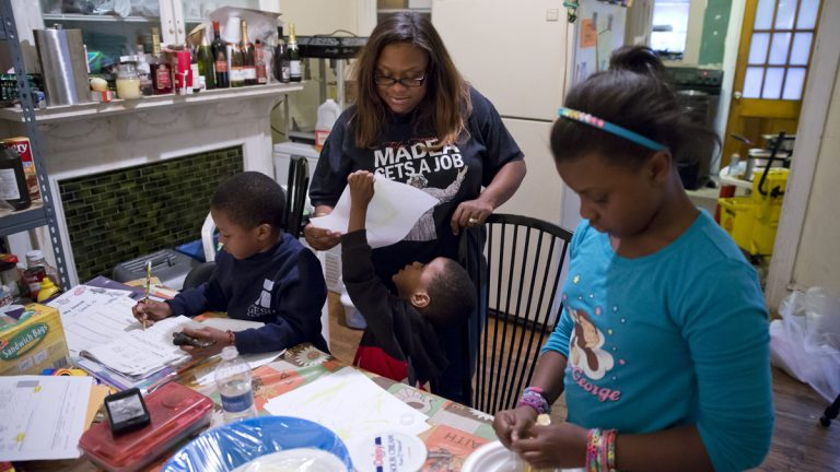 This AP file photo shows a Philadelphia family who receives money from the Supplemental Nutrition Assistance Program (Matt Rourke/AP Photo)