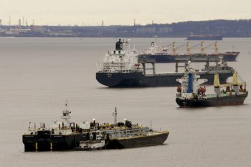 Ships and barges are idle in the middle of the Delaware River between Chester, Pa., and Wilmington, Del. (Chris Gardner/AP Photo)