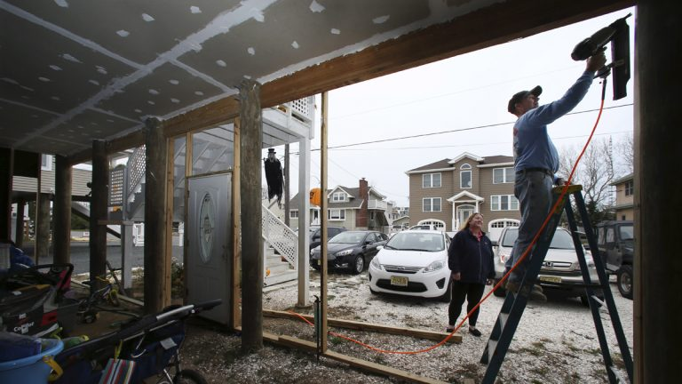 On Tuesday, while wife Dawn Markoski stands by, Stanley 'Sonny' Markoski works on their home that has been raised since being damaged, with about 27 inches of water in their house during Superstorm Sandy, in Long Beach Township, N.J. When FEMA announced that it would review Sandy-related claims to see if errors were made, the Markoskis submitted an application. The review concluded that they were owed an additional $55,972 in insurance money, nearly double what they had originally been paid. (Mel Evans/AP Photo)