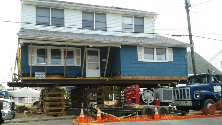 This Sept. 14, 2013 photo provided by John Paynter shows his house after it was raised in Long Beach Island, N.J. Paynter's vacation home now stands 13 feet higher than it did before Superstorm Sandy. The National Flood Insurance Program (NFIP) says floods are the No. 1 natural disaster in the U.S., with insurance claims totaling on average more than $3 billion annually from 2003 to 2012. (John Paynter/AP Photo)