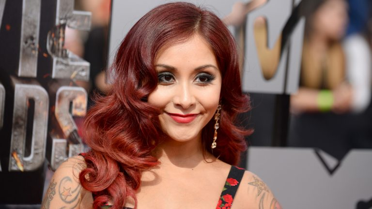 Nicole 'Snooki' Polizzi arrives at the MTV Movie Awards on Sunday, April 13, 2014, at Nokia Theatre in Los Angeles. (Photo by Jordan Strauss/Invision/AP)