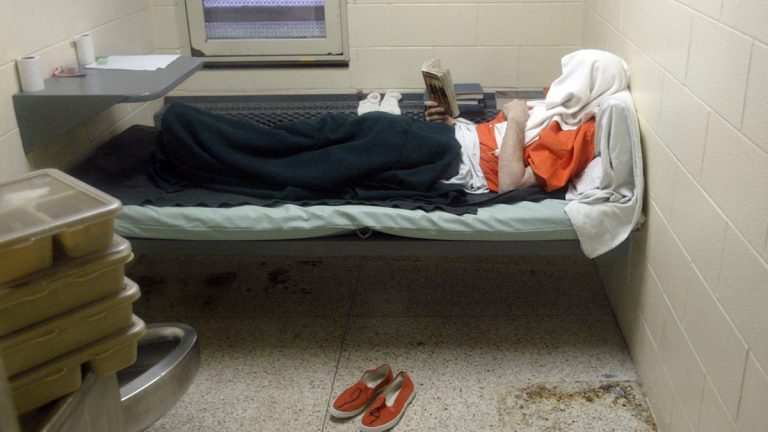 In this 2010 photo, an inmate who was transferred from the Pennsylvania Department of Corrections lies in his cell in a segregated area alone as punishment (Ken Stevens/AP Photo/The Muskegon Chronicle)