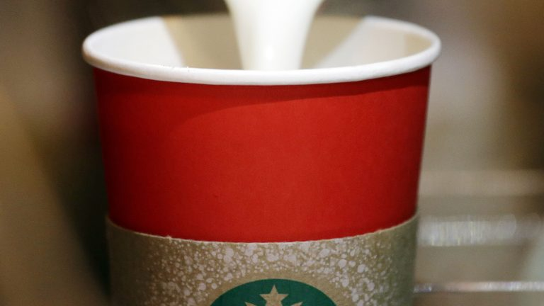 In this Tuesday, Nov. 10, 2015 file photo, a barista pours steamed milk into a red paper cup while making an espresso drink at a Starbucks coffee shop in the Pike Place Market in Seattle. An evangelist's Facebook diatribe criticizing Starbucks for supposedly taking Christ out of Christmas by designing cups without seasonal symbols has garnered millions of views in early November 2012. But few of the those known for longstanding concerns about a so-called 'War on Christmas' are joining his complaint. Others wonder how this controversy, if indeed it is one, fits into the long history of squabbles over the place of Christmas in the public square. (Elaine Thompson/AP Photo)