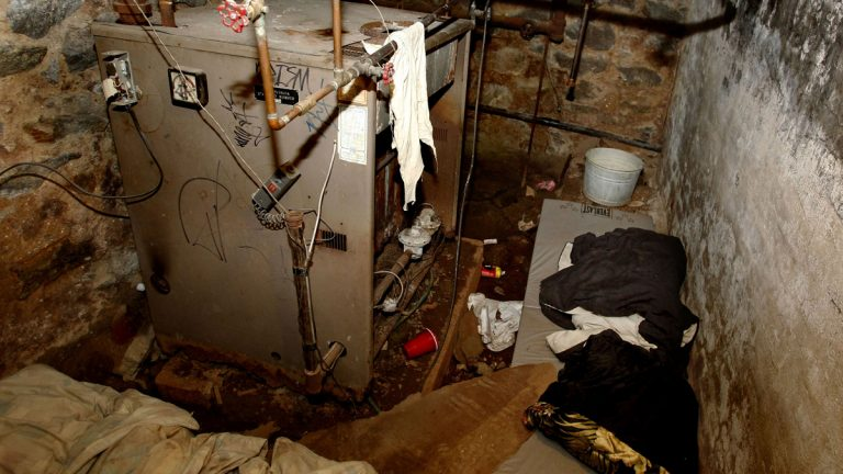 The dank basement room in Philadelphia where four weak and malnourished mentally disabled adults, one chained to the boiler, were found locked inside on Saturday is shown Monday, Oct. 17, 2011. (Ron Cortes/AP Photo, Pool)