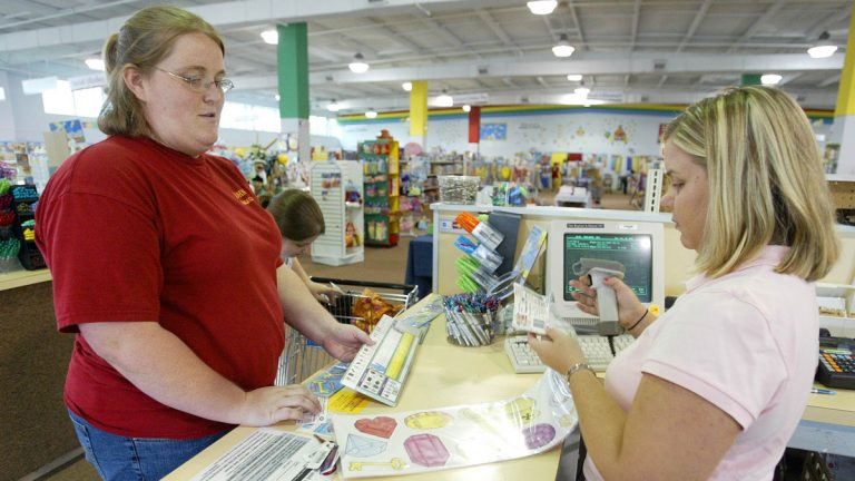 A sales associate rings up school supplies that a teacher is buying in this file photo (Wade Payne/AP Photo)