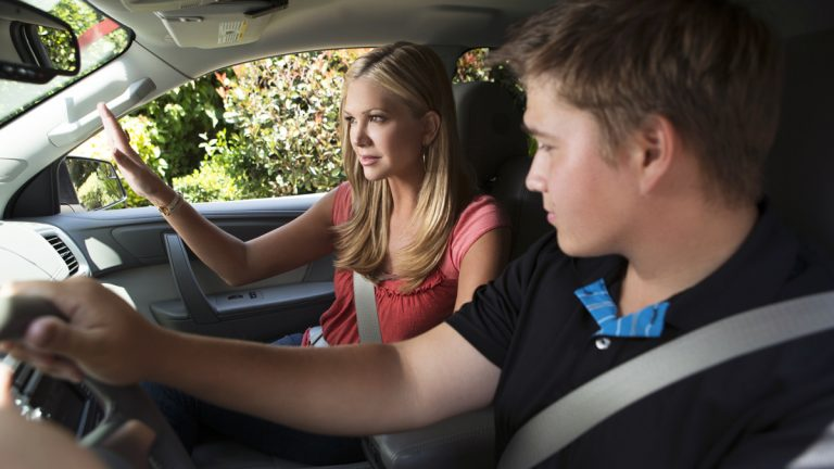 In this image released on Wednesday, July 3, 2013, Co-Host of Entertainment Tonight and mother, Nancy O'Dell, takes time to help coach stepson Tyler as he learns to drive. O'Dell is the spokesperson for Drive it Home – a campaign launched by the National Safety Council and The Allstate Foundation to provide resources for parents with teen drivers. (AP Images for the National Safety Council and The Allstate Foundation/Bret Hartman)