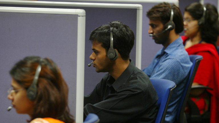 Employees answer calls at a call center (Gautam Singh/AP Photo, file)