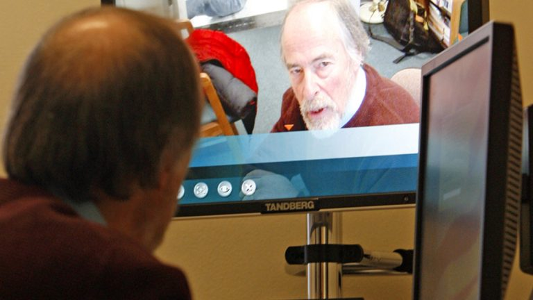 A psychiatrist counsels patients via Web cams, reaching people who sometimes went without such services. (Toby Talbot/AP Photo)