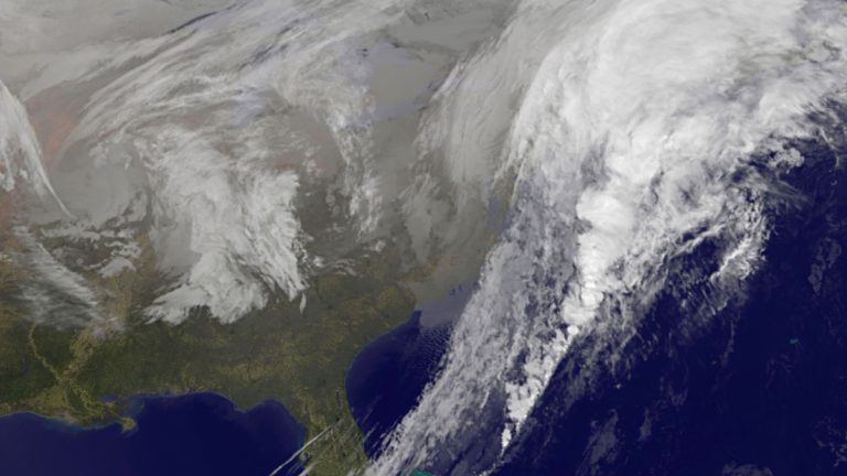 This satellite image taken at 5:30 p.m. EST on Wednesday, Nov. 26, 2014, and released by National Oceanic and Atmospheric Administration, shows a broad area of low pressure along the eastern seaboard of the United States. A sloppy mix of rain and snow rolled into the Northeast on Wednesday just as millions of Americans began the big Thanksgiving getaway, grounding hundreds of flights and turning highways hazardous along the congested Washington-to-Boston corridor. (AP Photo/NOAA)
