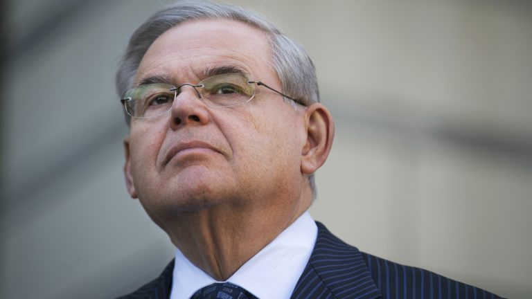 U.S. Sen. Bob Menendez waits to speak outside federal court, Thursday, April 2, 2015, in Newark, N.J. Menendez, the top Democrat on the U.S. Senate Foreign Relations Committee, was indicted on corruption charges, accused of using his office to improperly benefit an eye doctor and political donor. (AP Photo/John Minchillo)