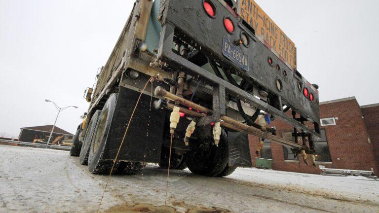 A Pennsylvania Department of Transportation anti-icing truck sprays a de-icing cocktail (Gene J. Puskar/AP Photo, file)