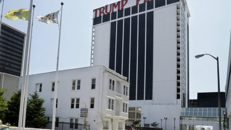 Trump Plaza Hotel and Casino towers over Vera Coking's three story rooming house Wednesday, July 23, 2014, in Atlantic City, N.J. The decrepit boarding home owned by the Atlantic City woman who has been turning down multi-million dollar offers for the building in the shadow of Trump Plaza since the 80's has sold at auction. (Mel Evans/AP Photo)