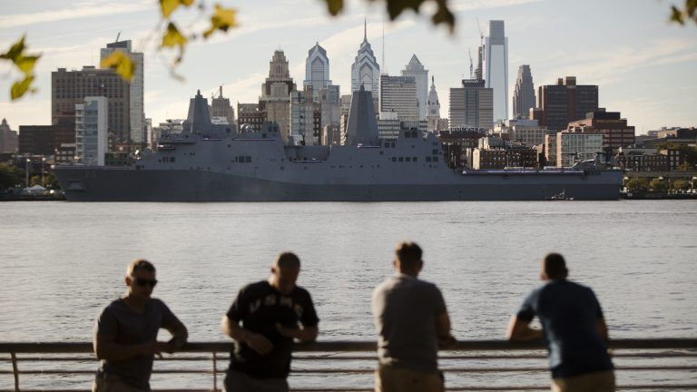 The USS John P. Murtha stands along the along the skyline of Philadelphia