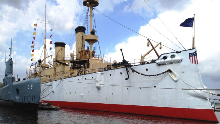 This undated photo provided by the Independence Seaport Museum from August 2012, shows the USS Olympia moored beside the submarine USS Becuna in Philadelphia. The USS Olympia, a one-of-a-kind steel cruiser from the Spanish-American War, has undergone extensive repairs that make it more stable than it has been in years (Hope Koseff Corse-Independence Seaport Museum/AP Photo)