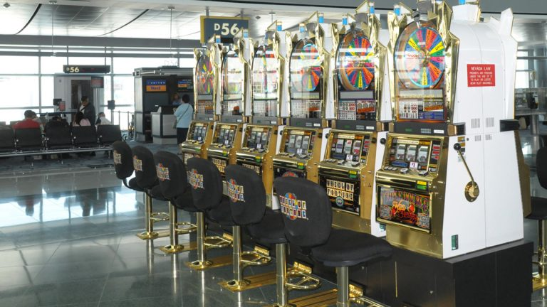 This undated photo shows some of the nearly 1,300 slot machines at McCarran Airport in Las Vegas. (AP Photo/Las Vegas News Bureau,Darrin Bush)