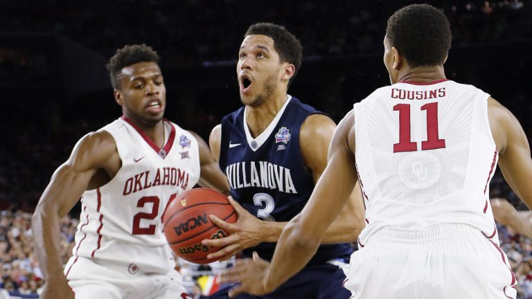 Villanova guard Josh Hart (3) moves between Oklahoma's Cousins (11) and Buddy Hield (24) during the second half of the NCAA Final Four tournament college basketball semifinal game Saturday