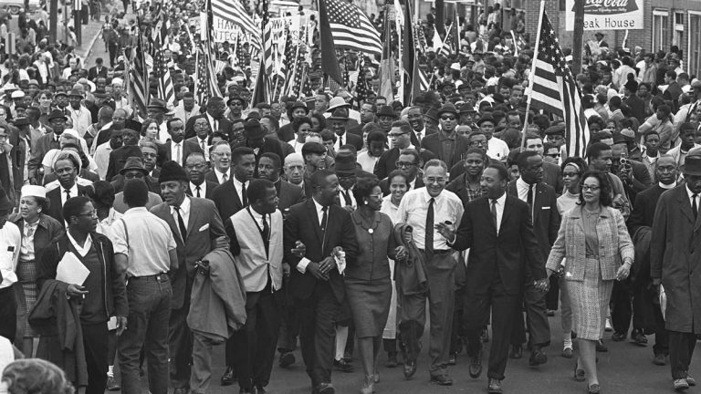 Dr. Martin Luther King, third from right, marchers across the Alabama River on the first of a five day, 50 mile march to the state capitol at Montgomery, Ala., on March 21, 1965.(AP Photo)