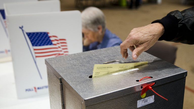 A voter casts a provisional ballot in the primary election Tuesday