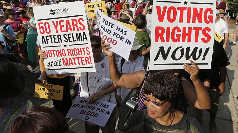 Demonstrators march through the streets of Winston-Salem, N.C., Monday, July 13, 2015, after the beginning of a federal voting rights trial challenging a 2013 state law. Election law experts say the case could determine how far Southern states can change voting rules after the nation's highest court struck down a portion of the federal Voting Rights Act just weeks before the North Carolina law was passed. (Chuck Burton/AP Photo)