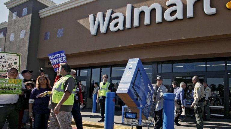 Protestors outside a Walmart store (Nick Ut/AP Photo)