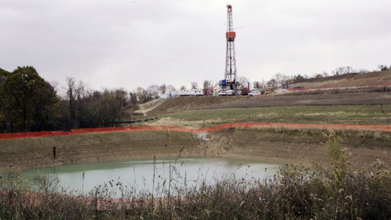 In this file photo, a drilling rig used to bore thousands of feet into the earth to extract natural gas from the Marcellus shale deep underground is seen on the hill above a reservoir in Houston, Pa. Wednesday, Oct. 29, 2008 (Keith Srakocic/AP Photo)