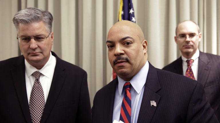 Philadelphia District Attorney Seth Williams accompanied by investigators Marc Costanzo, (left), and Frank Fina, after a news conference Monday, Jan. 27, 2014, in Philadelphia. (Matt Rourke/AP Photo)