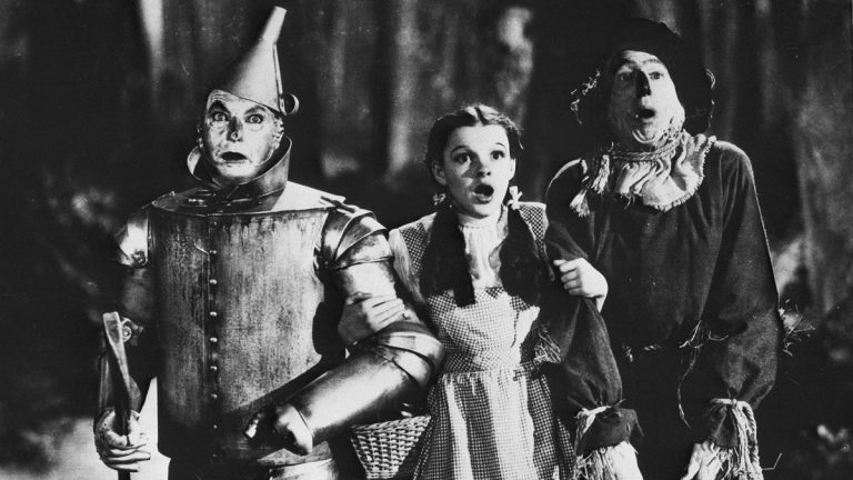 The Tin Woodman, Dorothy and the Scarecrow, played respectively by Jack Haley Jr., Judy Garland and Ray Bolger, are seen in the MGM film 'The Wizard of Oz,' 1939. (AP Photo/MGM)