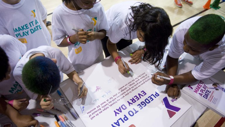 Kids pledge to exercise everyday at the Washington Y on Wednesday