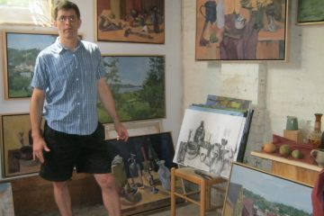 Artist Ian Tornay posing in his Queen Lane studio. (Alaina Mabaso/for NewsWorks)