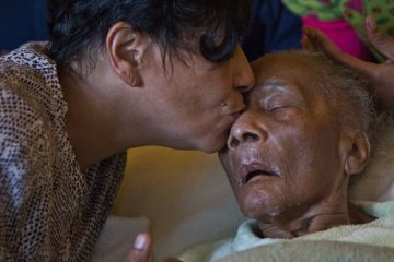 Angela Bobo and family members take turns caring for her mother