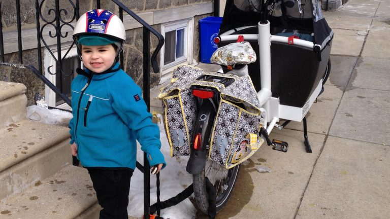 Layering is among the ways you can help keep children warm while bicycling during the cold winter months. (Dena Driscoll/for NewsWorks)