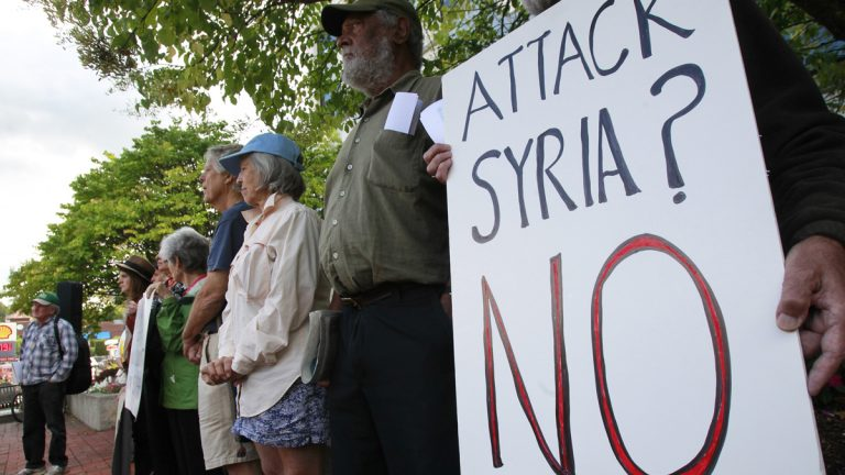 American protestors stand in opposition to military action in Syria. (AP Photo/Toby Talbot, file)