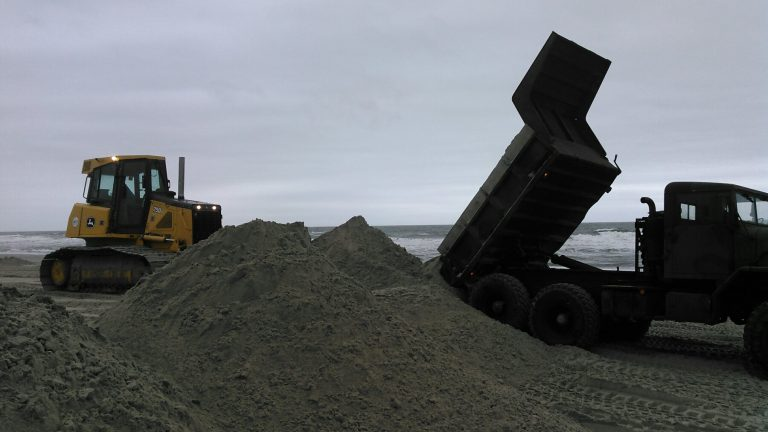 Avalon workers move sand on the beach. (Scott Wahl)