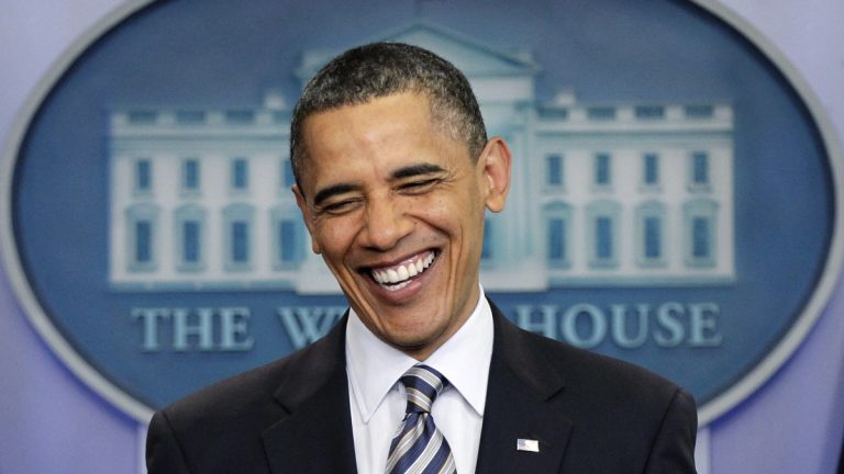 President Barack Obama is shown laughing as he comments to reporters on the controversy over his birth certificate in an April 2011 White House press conference. (AP Photo/J. Scott Applewhite