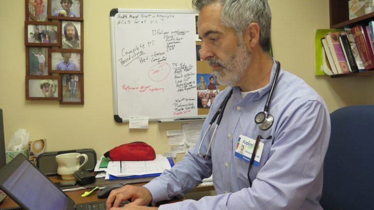Dr. Richard Rayner works at Harrisburg's Aspire Clinic with nurse practitioners. But, he says, the 'collaborative agreement' should remain in place.(Ben Allen/WITF)