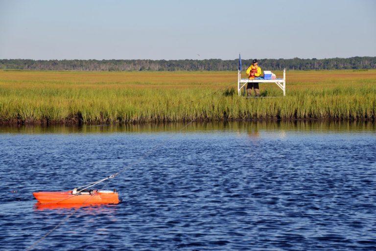 USGS scientist Zafer Defne measures water and sediment movement at Forsythe National Wildlife Refuge