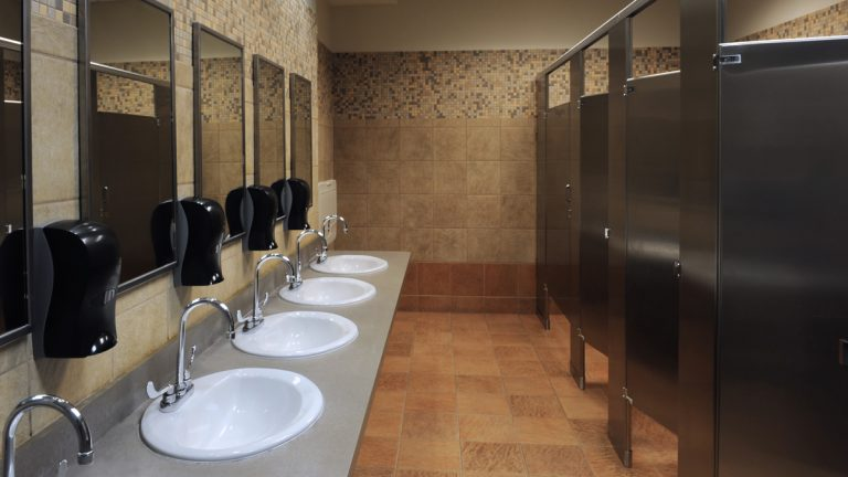 A new survey shows that many people use their work bathroom for reasons you wouldn't expect
