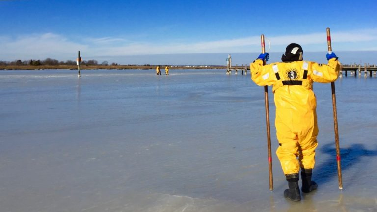 Seaside Park Volunteer Fire Department members conducting an ice rescue drill on the Barnegat Bay in Jan. 2015. (Photo: Justin Auciello/for NewsWorks)