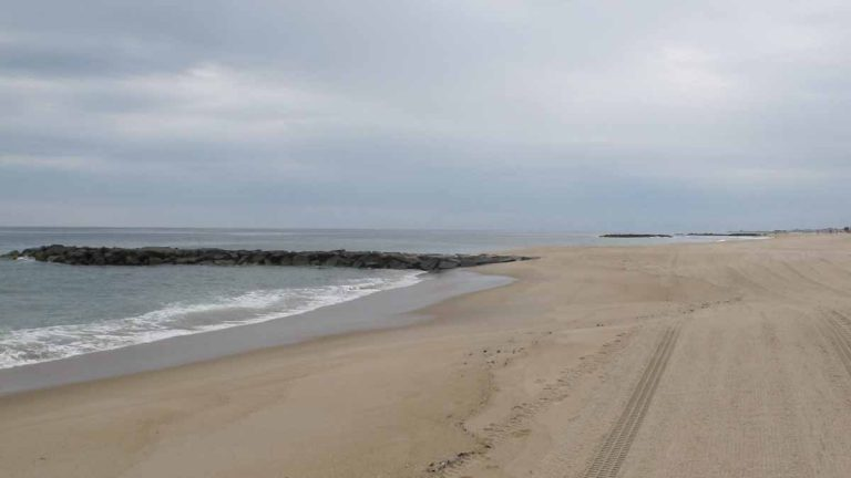 The Belmar beach stretches out before the beginning of the Memorial Day weekend. (Phil Gregory/WHYY)