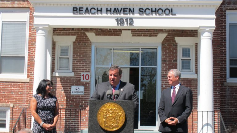 Superintendent Eva Marie Raleigh, Gov. Chris Christie, and Education Commissioner Chris Cerf speak at an event celebrating the reopening of the Beach Haven School. (Phil Gregory/for NewsWorks)