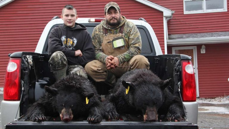 Bummer Cronk of Oak Ridge and his son, Hunter, 12, pose with their opening-day bears. (Emma Lee/for NewsWorks)