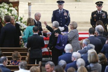 Vice President Joe Biden and his wife Jill greet mourners during the viewing for former Delaware Attorney General Beau Biden inside St. Anthony of Padua in Wilmington, Del., on Friday, June 5, 2015. Biden, the eldest son of Vice President Joe Biden, died of brain cancer Saturday at age 46. (William Bretzger/The Wilmington News-Journal via AP, Pool)