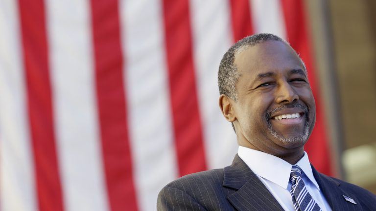 Republican presidential candidate Dr. Ben Carson looks on as he is introduced to speak at a town hall meeting, Friday, Oct. 2, 2015, in Ankeny, Iowa. (AP Photo/Charlie Neibergall)