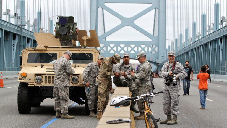 Members of the National Guard stand watch on the Ben Franklin Bridge during the papal visit (Emma Lee/WHYY)