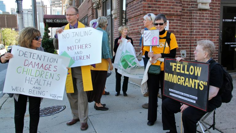 Unitarian-Universalists clergy and lay leaders from Reading and Philadelphia demonstrate outside the  Immigration and Customs Enforcement (ICE) building on Callowhill Street. The group is protesting detention of undocumented mothers and children in the Berks County Family Detention Center. (Emma Lee/WHYY)