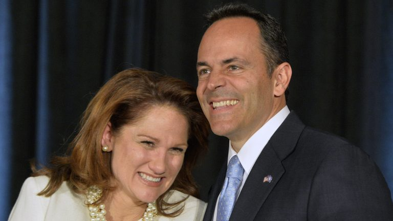 Kentucky Republican Gov.-elect Matt Bevin, right, and his wife Glenna react to the cheers of supporters during his introduction at the Republican Party victory celebration, Tuesday, Nov. 3, 2015, in Louisville. (AP Photo/Timothy D. Easley)