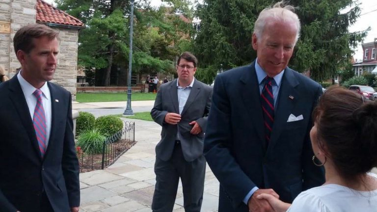 Vice President Joe Biden and Attorney General Beau Biden are shown paying their respects to Wilmington, Delaware, priest Father Roberto in August 2013. (Image courtesy of Nichole Dobo)
