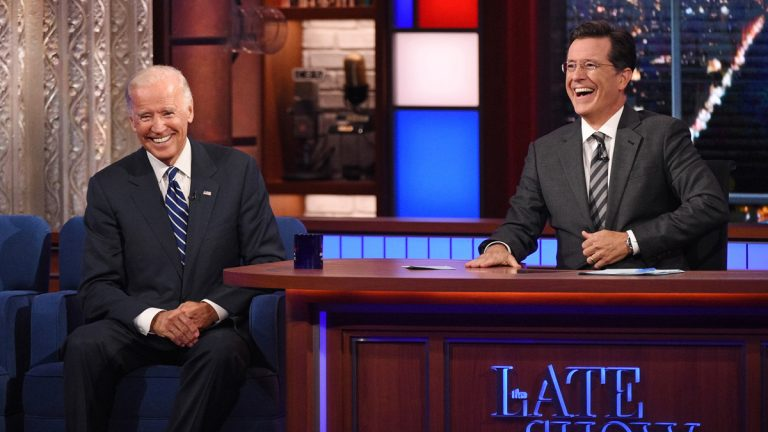 In this image released by CBS, host Stephen Colbert, right, laughs with Vice President Joe Biden during a taping of