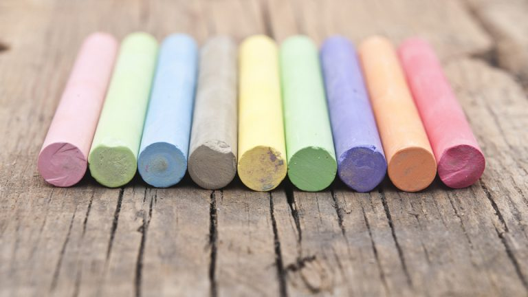 (<a href='http://www.bigstockphoto.com/image-53224528/stock-photo-colorful-chalks-on-old-wooden-table'>Big Stock</a>)