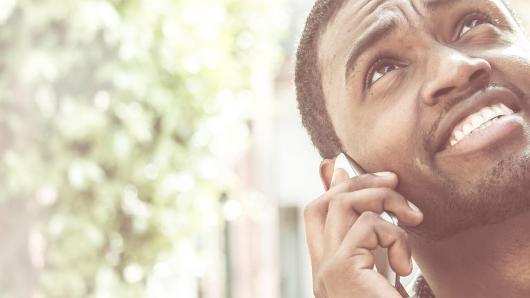 (<a href='http://www.bigstockphoto.com/image-134919275/stock-photo-young-african-american-man-using-mobile-phone-makes-a-call-close-up-on-face'>Big Stock Photo</a>)